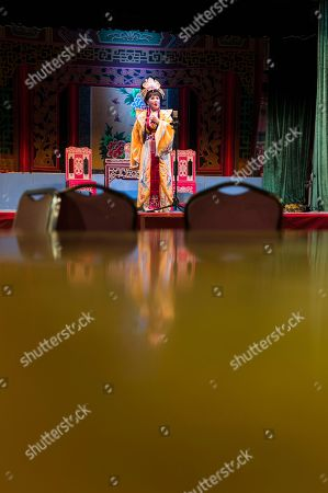 An actress performs during a Chiu Chow opera show in the New Territories in Hong Kong, China, 22 August 2018 (issued 23 August 2018). Around 1.2 million people originating from Chiu Chow (Chaozhou) in China's Guangdong province live in Hong Kong. During the Hungry Ghost Festival, they organise their own Yu Lan Ghost Festival, which includes opera performances for ghosts in need of a bit of entertaining. While the festival's origins are not unlike those of Halloween in Europe, it is also intrinsically linked to the Chinese practice of ancestor worship.