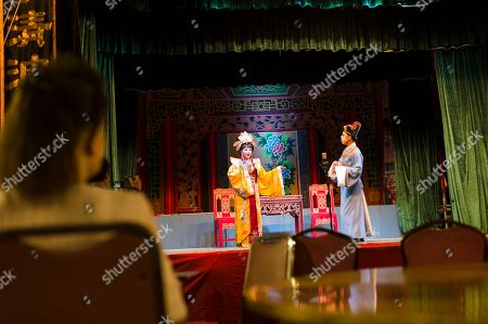 A guest watches a Chiu Chow opera performance in the New Territories in Hong Kong, China, 22 August 2018 (issued 23 August 2018). Around 1.2 million people originating from Chiu Chow (Chaozhou) in China's Guangdong province live in Hong Kong. During the Hungry Ghost Festival, they organise their own Yu Lan Ghost Festival, which includes opera performances for ghosts in need of a bit of entertaining. While the festival's origins are not unlike those of Halloween in Europe, it is also intrinsically linked to the Chinese practice of ancestor worship.