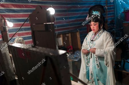 A Chiu Chow opera performer dresses in the backstage during a performance in the New Territories in Hong Kong, China, 22 August 2018 (issued 23 August 2018). Around 1.2 million people originating from Chiu Chow (Chaozhou) in China's Guangdong province live in Hong Kong. During the Hungry Ghost Festival, they organise their own Yu Lan Ghost Festival, which includes opera performances for ghosts in need of a bit of entertaining. While the festival's origins are not unlike those of Halloween in Europe, it is also intrinsically linked to the Chinese practice of ancestor worship.