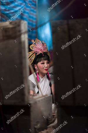 A Chiu Chow opera performer waits in the backstage during a performance in the New Territories in Hong Kong, China, 22 August 2018 (issued 23 August 2018). Around 1.2 million people originating from Chiu Chow (Chaozhou) in China's Guangdong province live in Hong Kong. During the Hungry Ghost Festival, they organise their own Yu Lan Ghost Festival, which includes opera performances for ghosts in need of a bit of entertaining. While the festival's origins are not unlike those of Halloween in Europe, it is also intrinsically linked to the Chinese practice of ancestor worship.