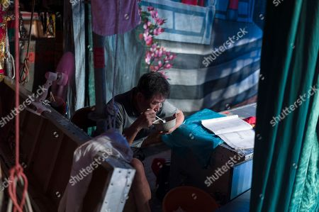 A Chiu Chow opera technician eats a bowl of congee in the backstage area during a performance in the New Territories in Hong Kong, China, 22 August 2018 (issued 23 August 2018). Around 1.2 million people originating from Chiu Chow (Chaozhou) in China's Guangdong province live in Hong Kong. During the Hungry Ghost Festival, they organise their own Yu Lan Ghost Festival, which includes opera performances for ghosts in need of a bit of entertaining. While the festival's origins are not unlike those of Halloween in Europe, it is also intrinsically linked to the Chinese practice of ancestor worship.