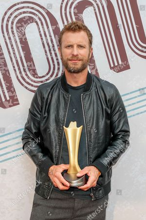 Dierks Bentley, with the ACM Merle Haggard Spirit Award, arrives at the 12th annual ACM Honors at the Ryman Auditorium, in Nashville, Tenn