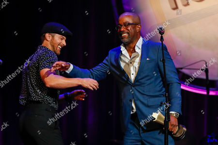 Darius Rucker, Kip Moore. Darius Rucker, right, accepts the ACM Gary Haber Lifting Lives Award from Kip Moore at the 12th Annual ACM Honors at the Ryman Auditorium, in Nashville, Tenn
