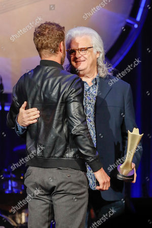 Ricky Skaggs, Dierks Bentley. Dierks Bentley, left, accepts the ACM Merle Haggard Spirit Award from Ricky Skaggs at the 12th Annual ACM Honors at the Ryman Auditorium, in Nashville, Tenn
