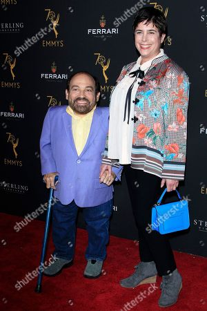 US actor Danny Woodburn (L) and guest arrive at the Television Academy Reception for the Daytime TV stars celebration of the 70th Emmy Awards at Saban Media Center in North Hollywood, Los Angeles, California, USA 22 August 2018.