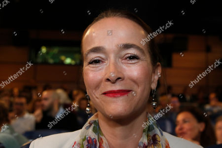 Delphine Ernotte Cunci, head of France Television, smiles during a press conference in Paris, Thursday, Aug.23, 2018
