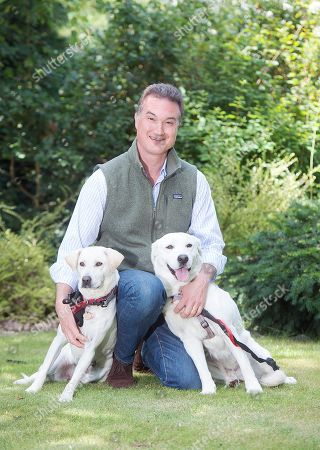 Editorial picture of Lord Robin Russell At Home In Woburn Estate Bedfordshire. He Has Helped Bring Two Dogs 'bounce' (smaller Dog) And 'elsa' Back From Dog Meat Farms In South Korea. Their New Owners Are Kate Sibley (pink Top) (bounce) And Louise Collins (elsa). Forj