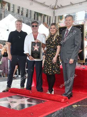 Simon Cowell, Kelly Clarkson, Rob Stringer, Leron Gubler