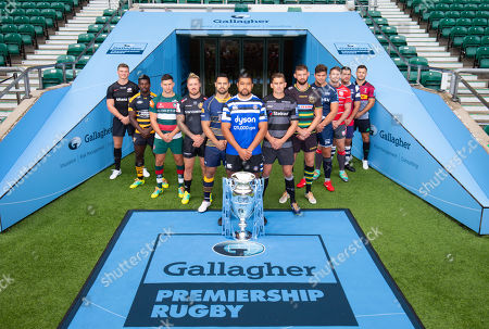 Players: Gloucester's Jaco Kriele, Newcastle Falcons' Toby Flood, Bath's Toby Faletau (Front with Trophy), Northampton Saints' Tom Wood, Leicester Tigers' Ben Youngs, Exeter Chiefs' Jack Nowell, Sale Sharks' Jono Ross, Harlequins' Danny Care, Bristol Bears' George Smith, Saracens' Owen Farrell, Wasps' Christian Wade and Worcester Warriors' Ben Te'o.
