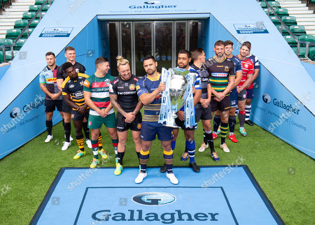 Players: Gloucester's Jaco Kriele, Newcastle Falcons' Toby Flood, Bath's Toby Faletau, Northampton Saints' Tom Wood, Leicester Tigers' Ben Youngs, Exeter Chiefs' Jack Nowell, Sale Sharks' Jono Ross, Harlequins' Danny Care, Bristol Bears' George Smith, Saracens' Owen Farrell, Wasps' Christian Wade and Worcester Warriors' Ben Te'o (Front  breaking all the rules by picking up the trophy!).