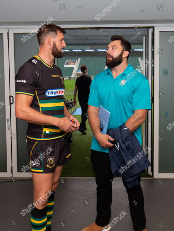 Northampton Saints' Tom Wood chats with Alex Corbisiero