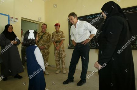 Editorial picture of Prime Minister Tony Blair Has Twinkle Twinkle Little Star Sung To Him At The Khadija Alkobra Girls School In The Southern Iraq Town Of Basra During His Visit. See Ross Benson Story.