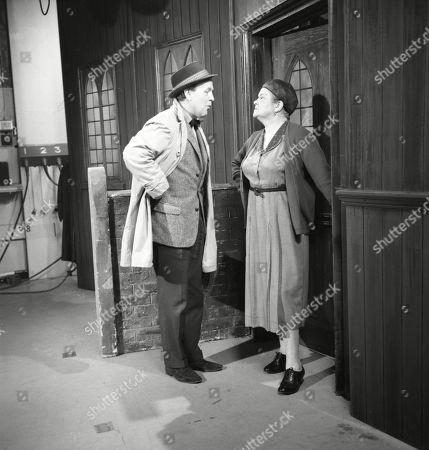 Derek Benfield (as Credit Salesman) and Violet Carson (as Ena Sharples)