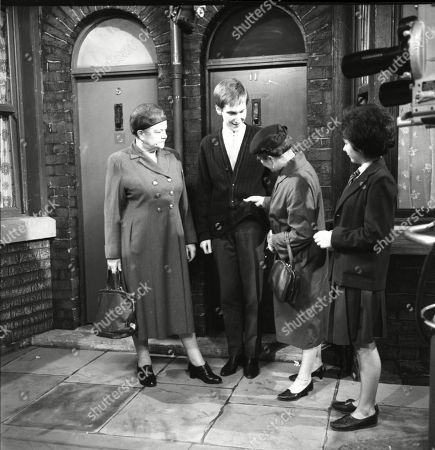 Stock Image of Violet Carson (as Ena Sharples), Christopher Sandford (as Walter Potts), Margot Bryant (as Minnie Caldwell) and Jennifer Moss (as Lucille Hewitt)