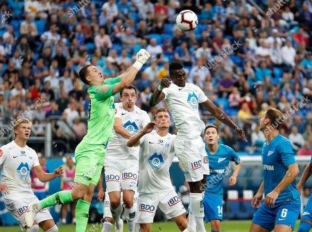 Zenit's goalkeeper Andrey Lunyov, left, jumps for the ball during the Europa League play-off round, first leg soccer match between Zenit and Molde at Petrovsky stadium in St. Petersburg, Russia