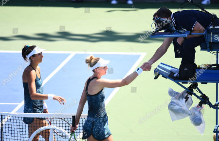 Naomi Broady shakes hands with the umpire after losing her 2nd Qualifying round match to Georgina Garcia Perez