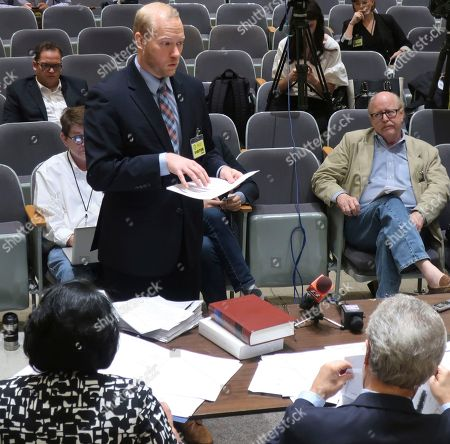 Will Lawrence, an attorney and aide to the Kansas Senate's top Democrat, testifies during a hearing on his legal challenge to independent candidate Greg Orman's right to be on the ballot in the governor's race, in Topeka, Kan. The board hearing the challenge ultimately rejected most of Lawrence's issues, allowing Orman to remain on the ballot