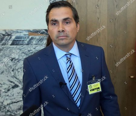 Greg Orman, independent candidate for Kansas governor, answers questions from reporters while a state board considers a legal challenge to his candidacy, in Topeka, Kan. The board has rejected most of the claims in a challenge filed by a Democrat, allowing Orman to stay on the ballot