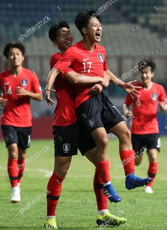 South Korea's Lee Seung-woo (R) and Son Heung-min (L) celebrate after scoring a second goal during their match against Iran in the men's football competition at the 18th Asian Games at Wibawa Mukti Stadium in Cikarang, Indonesia, 23 August 2018 (issued 24 August 2018).