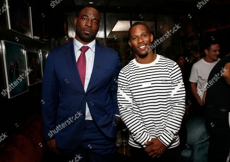 Justin Tuck, left, and Victor Cruz attend the NFL SUNDAY TICKET on DIRECTV 25th Season Kickoff Party at The Blond, in New York