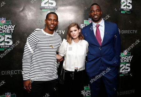 Victor Cruz, left, Kate Mara, and Justin Tuck attend the NFL SUNDAY TICKET on DIRECTV 25th Season Kickoff Party at The Blond, in New York