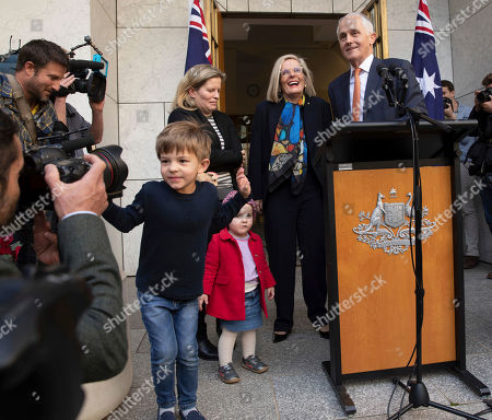 Outgoing Australian Prime Minister Malcolm Turnbull holds a final press conference with his wife Lucy Turnbull, second from right, and his daughter Daisy Turnbull-Brown, third from right, and his grandchildren Jack Turnbull-Brown and Alice Turnbull-Brown before leaving Parliament in Canberra, . Australia government lawmakers on Friday elected Treasurer Scott Morrison as the next prime minister in a ballot that continues an era of extraordinary political instability