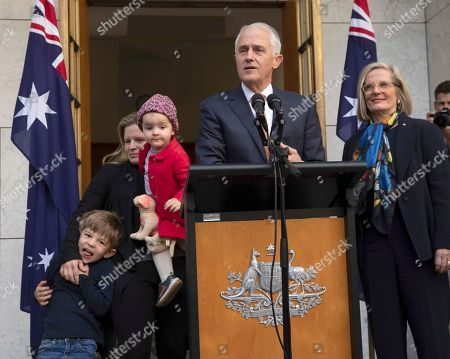 Outgoing Australian Prime Minister Malcolm Turnbull speaks during a final press conference with his wife Lucy Turnbull, right, and his daughter Daisy Turnbull-Brown and his grandchildren Jack Turnbull-Brown and Alice Turnbull-Brown before leaving Parliament in Canberra, . Australia government lawmakers on Friday elected Treasurer Scott Morrison as the next prime minister in a ballot that continues an era of extraordinary political instability