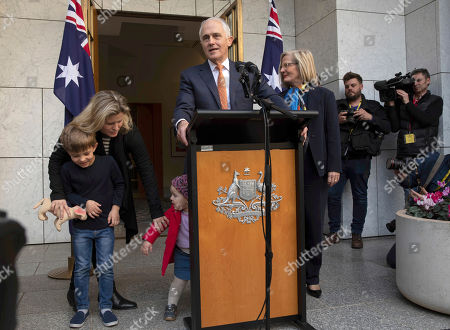 Outgoing Australian Prime Minister Malcolm Turnbull holds a final press conference with his wife Lucy Turnbull, right, and his daughter Daisy Turnbull-Brown, second from left, and his grandchildren Jack Turnbull-Brown and Alice Turnbull-Brown before leaving Parliament in Canberra, . Australia government lawmakers on Friday elected Treasurer Scott Morrison as the next prime minister in a ballot that continues an era of extraordinary political instability