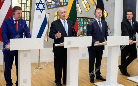 Saulius Skvernelis, Benjamin Netanyahu, Maris Kucinskis, Juri Ratas. Israel's Prime Minister Benjamin Netanyahu, second from left, speaks as Lithuania's Prime Minister Saulius Skvernelis, second from right, Latvia's Prime Minister Maris Kucinskis, left, and Estonia's Prime Minister Juri Ratas listen during a news conference at the Martynas Mazvydas National Library in Vilnius, Lithuania, . Netanyahu met with 3 Baltic prime ministers in a bid for European countries to counterbalance the criticism of Israel's actions in the occupied Palestinian territories and increase pressure on Iran