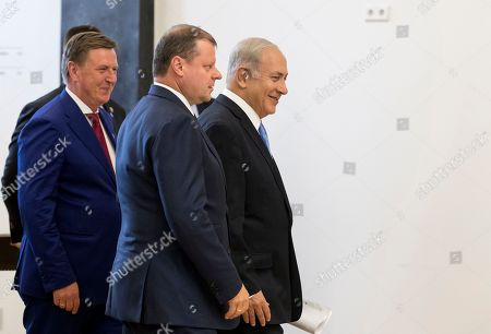 Saulius Skvernelis, Benjamin Netanyahu, Maris Kucinskis. Israeli Prime Minister Benjamin Netanyahu, right, Lithuania's Prime Minister Saulius Skvernelis, center, and Latvia's Prime Minister Maris Kucinskis arrive for a news conference at the Martynas Mazvydas National Library in Vilnius, Lithuania, . Netanyahu met with 3 Baltic prime ministers in a bid for European countries to counterbalance the criticism of Israel's actions in the occupied Palestinian territories and increase pressure on Iran