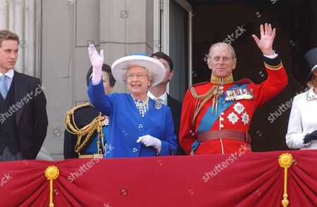 Trooping The Colour 2003. Queen Elizabeth II And Prince Philip In Uniform Wave To The Crowd After The Ceremony. The Young Royals Are Also In Attendance Prince Harry Prince William (l) And The Count And Sophie Countess of Wessex.  14/6/03
