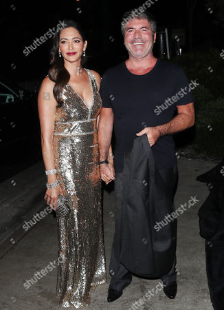 Stock Picture of Simon Cowell and Laura Silverman