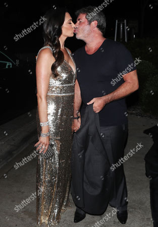 Stock Photo of Simon Cowell and Laura Silverman