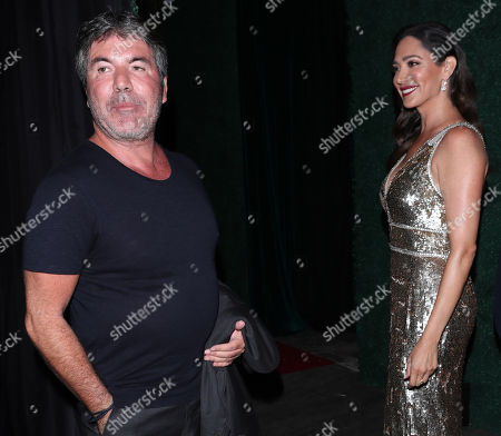 Stock Image of Simon Cowell and Laura Silverman