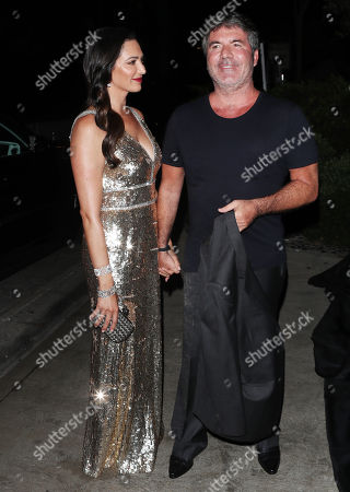 Simon Cowell and Laura Silverman