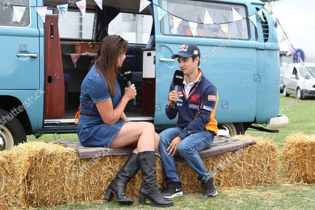 Dani Pedrosa interviewed by Suzi Perry for BT Sport during pre event for the GoPro British Grand Prix MotoGP at Silverstone, Towcester. Picture by Graham Holt