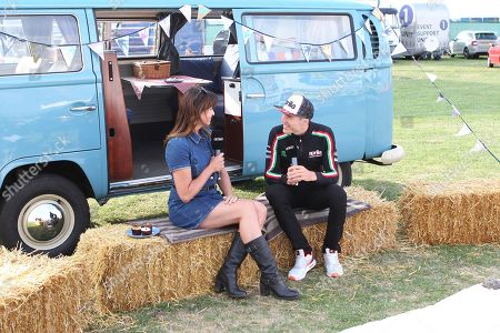 Stock Photo of Aleix Espargaro interviewed by Suzi Perry during pre event for the GoPro British Grand Prix MotoGP at Silverstone, Towcester. Picture by Graham Holt