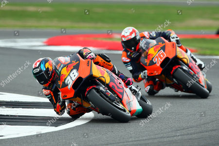 British MotoGP rider Bradley Smith (L) of the Red Bull KTM Factory Racing team in action during the free practice session of the 2018 Motorcycling Grand Prix of Britain at the Silverstone race track in Northampton, Britain, 24 August 2018.