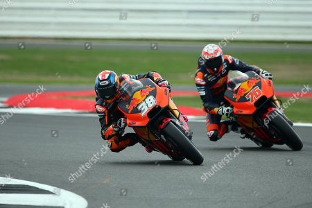 British MotoGP rider Bradley Smith of the Red Bull KTM Factory Racing Team and French MotoGP rider Loris Baz of the Red Bull KTM Factory Racing Team in action, during the MotoGP practice session of the 2018 Motorcycling Grand Prix of Britain at the Silverstone race track, Northampton, Britain, 24 August 2018.   (issued 26 August 2018)