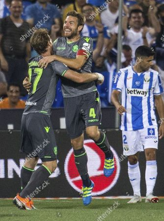 Real Sociedad's players Daviz Zurutuza (L) and Asier Illarramendi (R) celebrate after scoring the 1-0 lead against Leganes during a Spanish Primera Division soccer match at the Butarque stadium in Madrid, Spain, 24 August 2018.