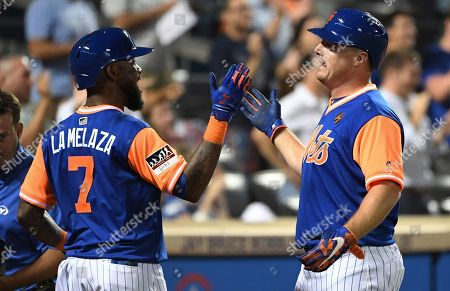 New York Mets 'Jose Reyes, left, greets Jay Bruce, who had hit a two-run home run against the Washington Nationals during the eighth inning of a baseball game, in New York