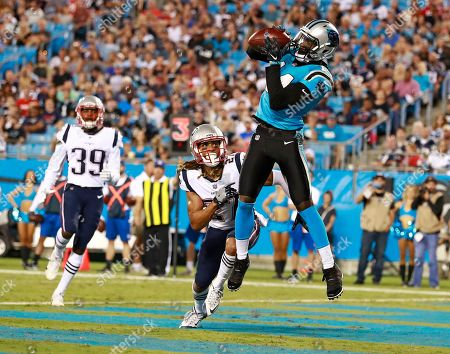 Carolina Panthers' Mose Frazier (14) catches a touchdown pass against New England Patriots' Ryan Lewis (27) during the second half of a preseason NFL football game in Charlotte, N.C