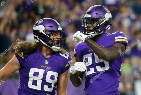 Minnesota Vikings running back Latavius Murray (25) celebrates with teammate David Morgan (89) after scoring on a 1-yard touchdown run during the first half of an NFL preseason football game against the Seattle Seahawks, in Minneapolis