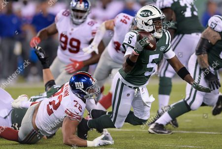 New York Jets quarterback Teddy Bridgewater (5) is sacked by New York Giants defensive end Kerry Wynn (72) during the third quarter of a preseason NFL football game, in East Rutherford, N.J
