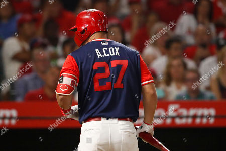 Los Angeles Angels' Mike Trout wears a jersey bearing a name of his brother-in-law, Aaron Cox, during the fourth inning of a baseball game against the Houston Astros, in Anaheim, Calif. Cox, a former minor-league baseball player, died at 24 on Aug. 15