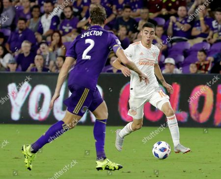 Stock Picture of Jonathan Spector, Miguel Almiron. Atlanta United's Miguel Almiron, right, looks for a way around Orlando City's Jonathan Spector (2) during the second half of an MLS soccer match, in Orlando, Fla