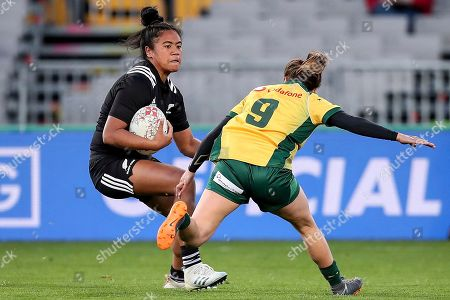 New Zealand's Alena Saili is challenged by Australia's Cobie-jane Morgan during the women's rugby test match at Eden Park in Auckland, New Zealand