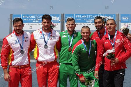 Gold medalists Hungary's Mark Balaska/Balazs Birkas (C), Silver medalists Spains' Saul Craviotto/Cristian Toro (L) and Bronze medalists Serbia's Nebojsa Grujic/Marko Novakovic celebrate on the podium of K2 men 200m Final A at 2018 ICF Canoe Sprint World Championships in Montemor-o-Velho, Portugal, 25 August 2018.
