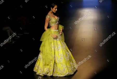 Bollywood actress Malaika Arora walks the ramp to showcase a creation by Anushree Reddy during Lakme Fashion Week in Mumbai, India