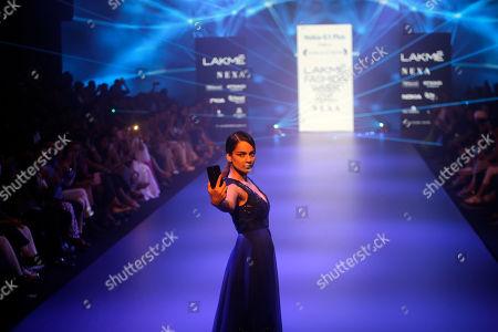 Bollywood actress Kangana Ranaut walks the ramp displaying a creation by Pankaj and Nidhi during Lakme Fashion Week in Mumbai, India